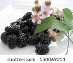 Blackberries And Flowers Of...