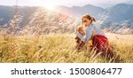 Stock photo smiling female hugs her beagle dog resting as they walking in mountains together 1500806477