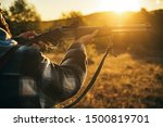 Hunter with shotgun gun on hunt. Illegal Hunting Poacher in the Forest. American hunting rifles. Hunting without borders - stock photo