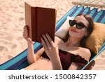 Young Woman Reading Book In...