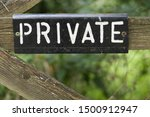 Old Private Sign On Wooden Gat...