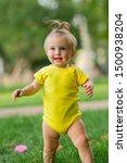 Baby Girl In Yellow Bodysuit...