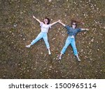 Two Girl Lying In The Grass In...