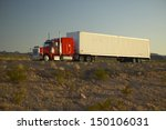 Small photo of MOJAVE DESERT, CA - JULY 29: 18-wheeler semi-trucks hit the highway driving down Interstate Highway 15 between Los Angeles and Las Vegas Nevada on July 29, 2004 in Southern California