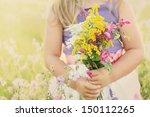little girl holding wild... | Shutterstock . vector #150112265
