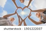 A Group Of Youth Makes A Heart...
