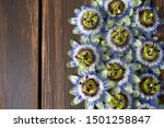 Passion Flowers On Dark Wooden...