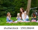 young mother and her daughters... | Shutterstock . vector #150138644