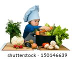 cute little girl cooking soup...