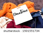 Small photo of Clothes heap. there is a large pile of sketched clothes, notebook with donations, coat drive, donation concept