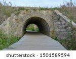 Wooden Footbridge Passes Under...