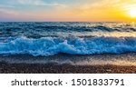 Waves on the seashore at sunset.