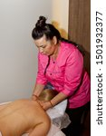 Small photo of professional therapeutic back massage. Woman doctor massages girl the athlete in a massage room. body and health care. pain recovery procedure.