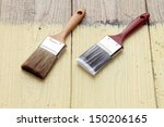 new paint brush on a wooden... | Shutterstock . vector #150206165