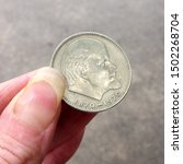 Macro photo money silver USSR coin. Photo money silver vintage soviet union coin with Lenin portrait. USSR coin in hand