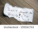 don't forget to smile   hand... | Shutterstock . vector #150261761
