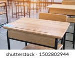 Small photo of School empty classroom or lecture room interior with desks chairs iron wooden without young student and prepareing for test exam or studying lessons of secondary education. Back to school concept