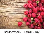 raspberries on wooden table... | Shutterstock . vector #150310409