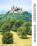 Small photo of Hohenzollern Castle on mountain top, Germany. This fairytale castle is famous landmark in Stuttgart vicinity. Scenic view of Burg Hohenzollern in summer. Landscape of Swabian Alps with Gothic castle.
