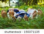 family relaxing on the grass | Shutterstock . vector #150371135