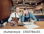 Small photo of Young entrepreneurs overwhelmed by finance problems - Nervous manager checking restaurant finance - Failure in small-business concept