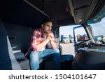 Truck Driver Sitting In His...