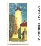 Old postage stamp from USA with Lighthouse - stock photo