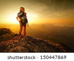 lady hiker with backpack... | Shutterstock . vector #150447869