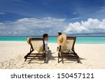 couple on a tropical beach at... | Shutterstock . vector #150457121