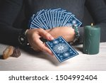 Small photo of Tarot cards in fortune teller hands concept.
