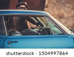 Oldtimer Classic Ride. Caucasian Cowboy Getting Into the Car. Closeup Photo. Transportation and Lifestyle Theme. - stock photo