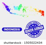 Rainbow colored dot Indonesia map and watermarks. Blue rounded Senior Airman textured watermark. Gradient rainbow colored Indonesia map mosaic of scattered small circles.
