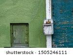 Green Wall And Small Door
