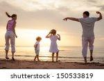 happy beautiful family dancing... | Shutterstock . vector #150533819