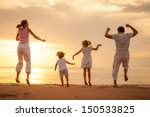 happy beautiful family dancing... | Shutterstock . vector #150533825