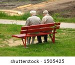 Two Older Man Sitting On The...