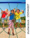cheerful friends climbing the... | Shutterstock . vector #150544307