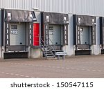 Empty Loading Dock Cargo Door as a Symbol for Economic Growth - stock photo