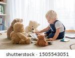 Little Toddler Boy  Reading A...