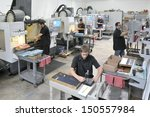 CNC machine shop with lathes, technicians and workers - stock photo