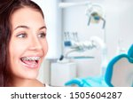 Small photo of Beautiful young woman with teeth braces in the orthodontist's office.