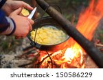 cooking in a pot on the fire | Shutterstock . vector #150586229