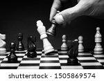 Business man playing chess  ...