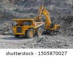 Excavator Loads Ore Into A...