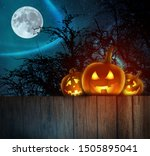Stock photo spooky halloween pumpkins on wood halloween background at night forest with moon 1505895041