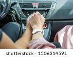 Romantic couple holding hands...