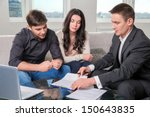 couple consults with agent ... | Shutterstock . vector #150643835