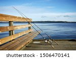 Two Fishing Rods On The Pier...