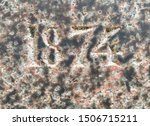 The year 1874 carved in polished granite – a detail of an inscription produced that year. Originally the inscription was probably painted or gilded