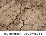 A Brown Torn Soil Due To Drought